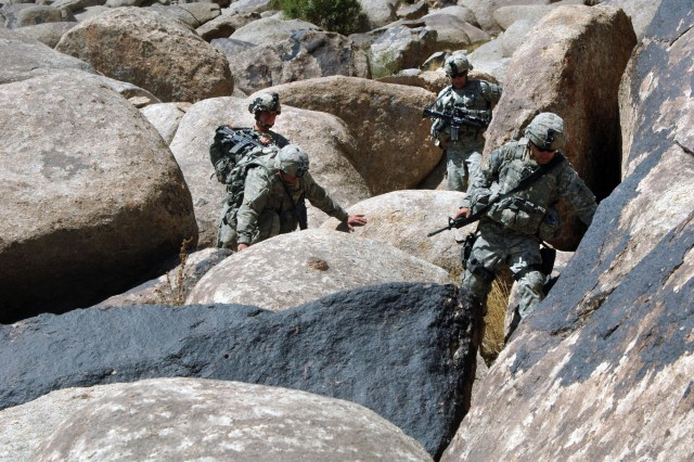Soldiers from Company B, 2nd Battalion, 508th Parachute Infantry Regiment search a mountain for the Taliban and their weapons caches in Waghez, Afghanistan, Sept. 19.