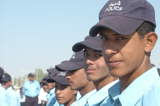 Iraqi Police graduates stand in formation awaiting the start of their graduation ceremony at Iraq Army Camp India in Baghdad Sept. 25. More than 800 volunteers from the Abu Ghraib area of Baghdad graduated the 30 day training and are now Iraqi police officers. They will return to their own neighborhoods to help provide security.