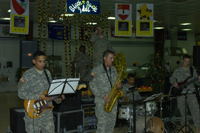 Milwaukee native Pfc. Daniel Jens, a member of 3rd Battalion, 82nd Field Artillery Regiment, 2nd Brigade Combat Team, 1st Cavalry Division, performs with the 1st Cav. Div. Jazz Band during the finals of Black Jack Idol, which was held at Forward Operating Base Prosperity in central Baghdad Sept. 20.