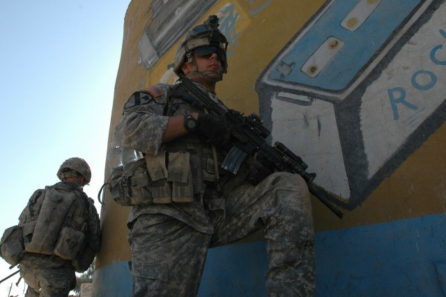 Operation Rock Wrench clears industrial section of Baqouba - Spc. Garrett Vogland of 1-12 Combined Arms Battalion, 3rd Brigade Combat Team, 1st Cavalry Division, provides security for Iraqi soldiers during Operation Rock Wrench Sept 22.  Iraqi forces focused on clearing structures while U.S. forces provided security for the mission in the industrial section of south Baqouba.