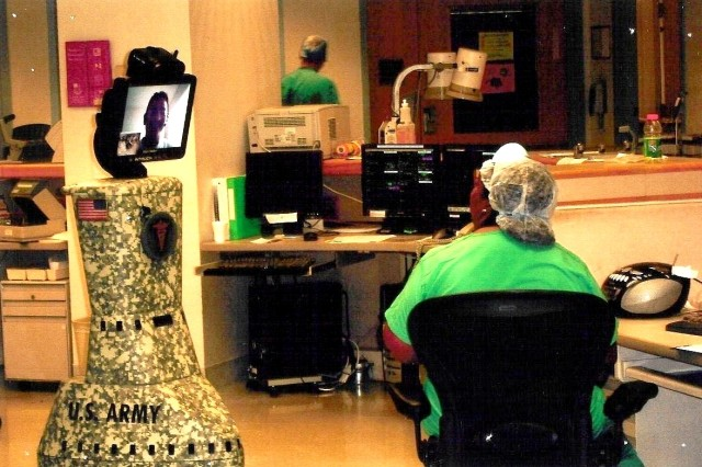 The mobile robot (left) can roll to a patient's bedside and enable two-way, real time communication between a physician and a patient, patient's family, other physicians and nurses.