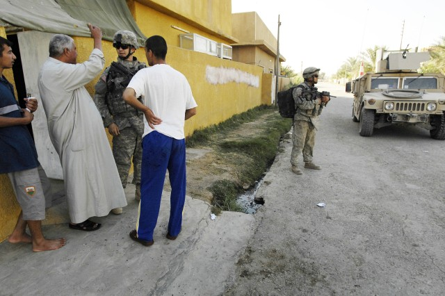 Soldiers interview the locals to hear their concerns and to collect information that will improve security.