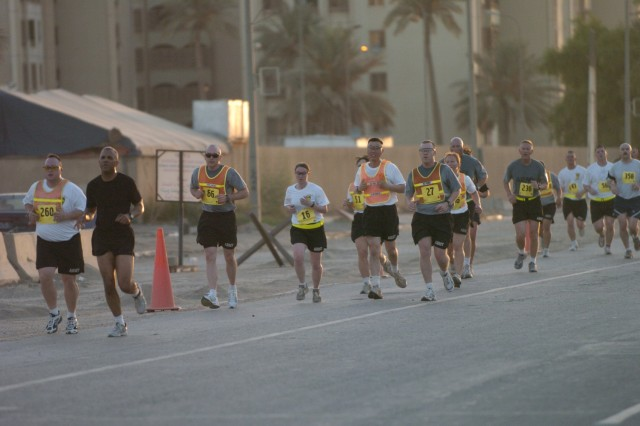 A line of runners make their way through Baghdad's International Zone during the Black Jack Eight-Miler, hosted by the 2nd Brigade Combat Team, 1st Cavalry Division Sept. 29.