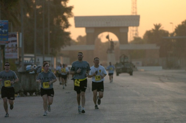 The sun begins to rise over Baghdad's International Zone as runners participate in the Black Jack Eight-Miler, which was hosted by the 2nd Brigade Combat Team, 1st Cavalry Division Sept. 29.