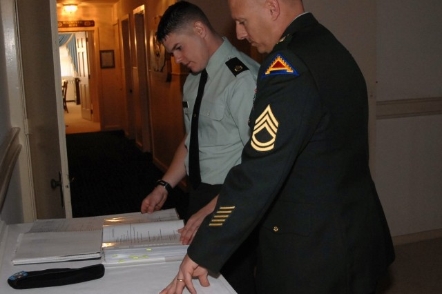 Contestant, Staff Sgt. Travis Snook, gets last-minute tips from sponsor, Sgt. 1st Class Paul Garrett, just before Snook's board appearance at  the 2007 Noncommissioned Officer of the Year competition Oct. 1, 2007.