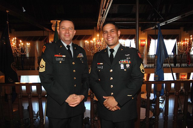 Sponsor Sgt. Maj. Mark Eister and contestant Staff Sgt. Victor Trinidad pose for pictures just before Trinidad's board appearance during the 2007 Noncommissioned Officer of the Year competition Oct. 1 at Fort Lee, Va.