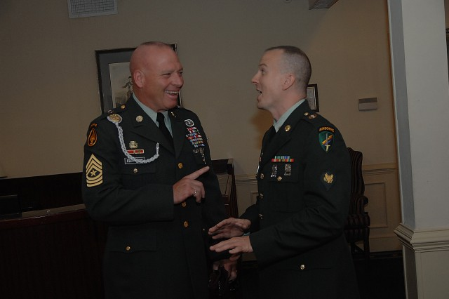 """Sponsor  Sgt. Maj. Charlie Ferguson and contestant Spc. Brian Hancock share a laugh after Hancock's board appearance during the 2007 Soldier of the Year competition Oct. 1 at Fort Lee, Va."""""""