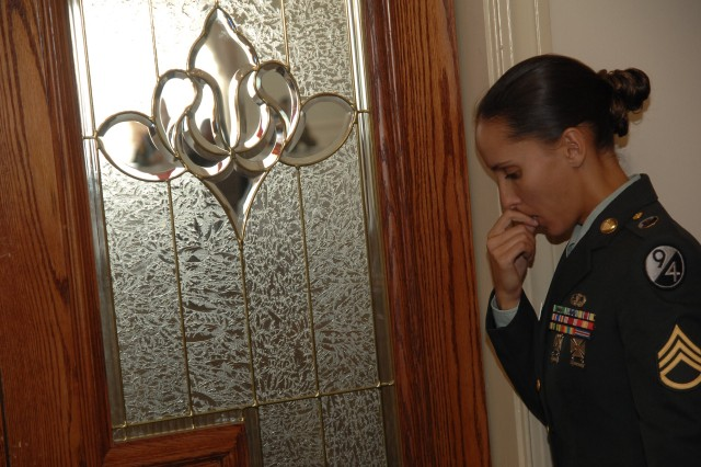 """Sponsor Staff Sgt. Sandy Gomes listens in during her Soldier's board appearance. The Soldier, Sgt. Edward Chisholm, is a contestant in the 2007 Noncommissioned Officer of the Year competition Oct. 1-5 at Fort Lee, Va."""""""