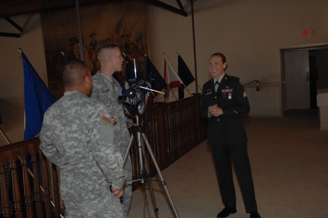 Sgt. Jamiell Goforth, FORSCOM Soldier of the Year, conducts a broadcast interview minutes after her board appearance during the 2007 Department of the Army Soldier of the Year Competition Oct. 1 at Fort Lee, Va.
