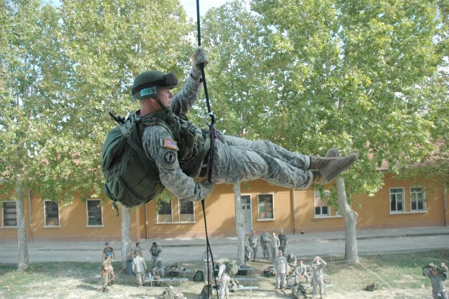 Sgt. Daniel Gaumer makes the full combat load repel look easy as he proceeds down the ropes.