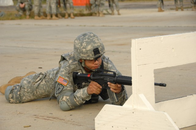 "Competitor Pfc. Patrick Murphy negotiates a barricade as part of a reflexive fire exercise during the 2007 Noncommissioned Officer/Soldier of the Year competition Oct. 2 at Fort Lee, Va. The exercise prepares the Soldier for an upcoming ""urban warfare"" range event."