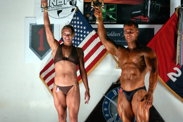 The overall winners of the 2nd Baghdad Classic Bodybuilding and Figure Competition, College Park, Md., native Spc. Allison Schlegel and Staff Sgt. Joseph Fiorani from Eldersburg, Md., both from the 58th Infantry Brigade Combat Team, pose for pictures taken at the conclusion of the 2nd Baghdad Classic Body Building and Figure Competition at the Morale, Welfare and Recreation Field House at Camp Liberty in western Baghdad Sept. 29.