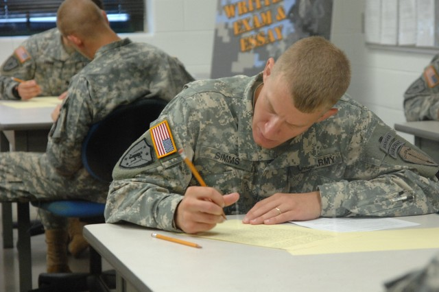 Staff Sgt. Blake Simms, representing the U.S. Army Training and Doctrine Command, works on the written examination on general military topics and a graded essay on an assigned topic, as part of 2007 Best Warrior Competition, Oct. 3, at Fort Lee, Va.