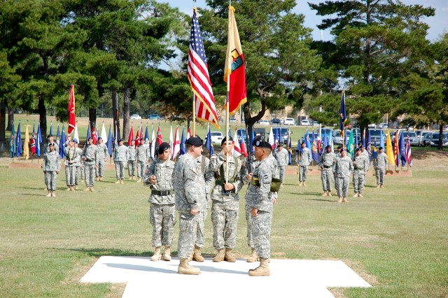 Col. Gregory Watt, commander of the 1st Combat Support Brigade (Maneuver Enhancement), and Command Sergeant Major Ted Lopez, 1st CSB CSM, uncase the unit's colors during its Oct. 2 activation ceremony.
