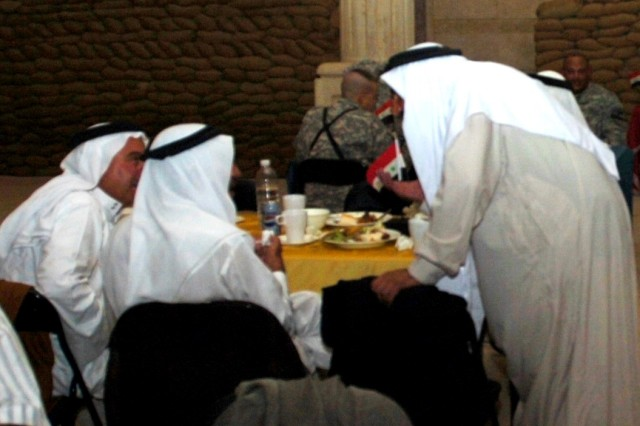 Sheiks from the Abu Ghraib district of Baghdad converse during a dinner held at Camp Liberty, Iraq Oct. 1 in celebration of the success of recent reconciliation efforts within the district.