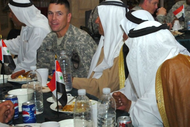 "Lt. Col. Kurt Pinkerton, commander, 2nd ""Lancer"" Battalion, 5th Cavalry Regiment shares a laugh with tribal leaders from throughout the Abu Ghraib district during a dinner held at Camp Liberty, Iraq Oct. 1 to celebrate the success of recent Abu Ghraib reconciliation efforts."