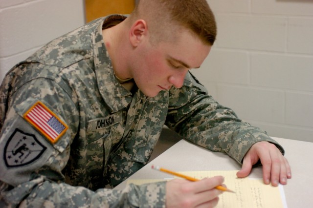 Sgt. Nicholas Johnson, 8th U.S. Army Soldier of the Year, writes down answers to the 20 essay questions of the written exam during the Department of the Army Soldier/NCO of the Year competition at Fort Lee, Va. Oct. 3.