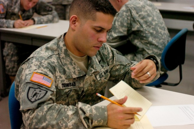 Staff Sgt. Victor Trinidad, 8th U.S. Army NCO of the Year, writes down answers to the 20 essay questions of the written exam during the Department of the Army Soldier/NCO of the Year competition at Fort Lee, Va. Oct. 3.