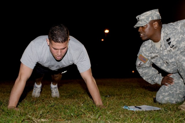 Competitor Staff Sgt. Victor Trinidad conducts the Army Physical Fitness Test during the 2007 Noncommissioned Officer/Soldier of the Year competition Oct. 3 at Fort Lee, Va.