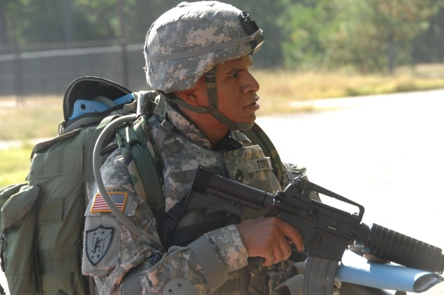 Competitor Staff Sgt. Jorge Toro negotiates the Urban Warfare Orienteering Course during the 2007 Noncommissioned Officer/Soldier of the Year competition Oct. 3 at Fort Lee, Va.