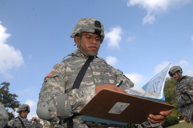 Competitor Staff Sgt. Jorge Toro looks at his map before starting the Urban Warfare Orienteering Course event of the Department of the Army Best Warrior Competition at Fort Lee, Va., Oct. 1-5.