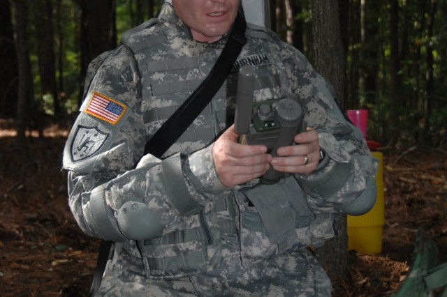 Staff Sgt. Russell Burnham uses a plugger during the Urban Warfare Orienteering Course event of the Department of the Army Best Warrior Competition at Fort Lee, Va., Oct. 1-5.