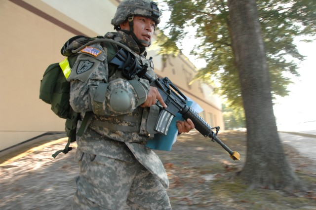 Competitor Spc. Heyz Seeker negotiates the Urban Warfare Orienteering Course during the 2007 Noncommissioned Officer/Soldier of the Year competition Oct. 3 at Fort Lee, Va.