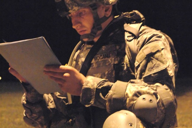 Cpl. Mihai Mocanu, U.S. Army-Europe, checks his map for the first checkpoint at the start of the night land navigation event during the 2007 Department of the Army NCO/Soldier of the Year Competition at Fort Lee, Va., Oct. 3.