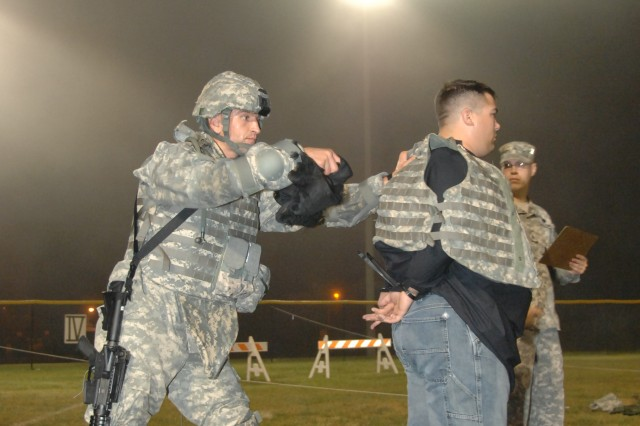 Competitor Cpl. Mihai Mocanu conducts detainee operations during the 2007 Department of the Army Noncommissioned Officer/Soldier of the Year Competition Oct. 4 at Fort Lee, Va.