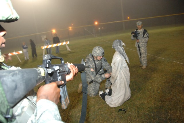Competitor Staff Sgt. Jason Seifert conducts detainee operations during the 2007 Department of the Army Noncommissioned Officer/Soldier of the Year Competition Oct. 4 at Fort Lee, Va.