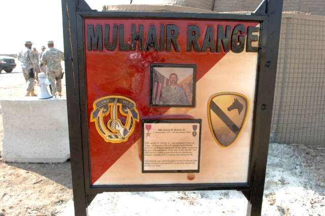 Omaha, Neb. native Staff Sgt. Jeremy W. Mulhair, Sr., a platoon sergeant for Troop A, 1st Squadron, 7th Cavalry Regiment is memorialized on a sign to the newly opened range named in his honor and dedicated during a ceremony on Camp Taji, Iraq Oct. 2. While on a mounted patrol, Mulhair was killed Nov. 30 in Ash Shulah, Iraq after an improvised explosive device detonated.