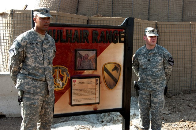 Pipe Creek, Texas native Capt. Robert Richardson (right), commander, and 1st Sgt. Allen Mouton, top noncommissioned officer, both of Troop A, 1st Squadron, 7th Cavalry Regiment, pose for a photo next the Mulhair range sign during a dedication ceremony for the newly opened range on Camp Taji, Iraq Oct. 2. The range was named in honor of Richardson and Mouton's Soldier, Staff Sgt. Jeremy W. Mulhair, Sr., a Troop A platoon sergeant, who hailed from Omaha, Neb. and was killed Nov. 30 after his humvee was struck by an improvised explosive device in the village of Ash Shulah, Iraq.