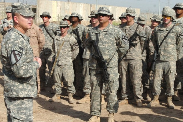 """Col. Paul E. Funk II, commander, 1st """"Ironhorse"""" Brigade Combat Team, 1st Cavalry Division, speaks to troopers from the 1st Squadron, 7th Cavalry Regiment during the dedication of the newly opened Mulhair Range on Camp Taji, Iraq Oct. 2. The range was named in honor of Omaha, Neb. native Staff Sgt. Jeremy W. Mulhair, Sr., a platoon sergeant for Troop A, 1st Squadron, 7th Cavalry Regiment, who was killed Nov. 30 when his vehicle struck an improvised explosive device in the village of Ash Shulah, Iraq."""