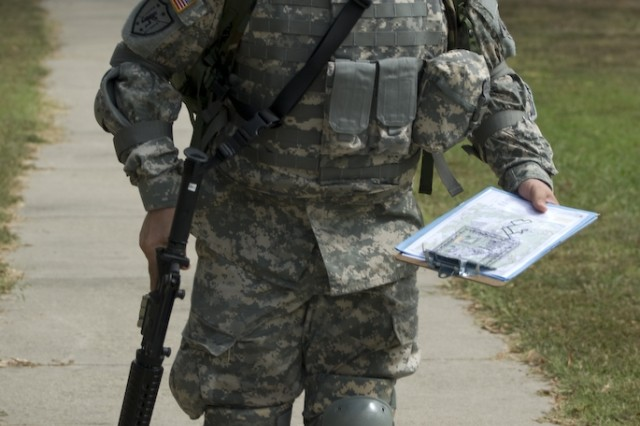 Staff Sgt. Victor Trinidad runs to his first point during the land navigation event at the 2007 Best Warrior Competition.