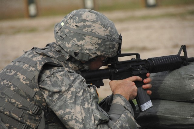 Competitor Spc. Brian Hancock zeroes his weapon prior to qualifying with the M4 during the 2007 Department of the Army Noncommissioned Officer/Soldier of the Year Competition at Fort Lee, Va., Oct. 4.