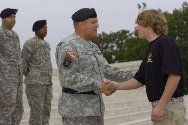 Vice Chief of Staff of the Army Gen. Richard Cody congratulates a newly-enlisted Logan Bilyeu of Bend, Ore., during the Recruiting Mission Success Ceremony at the Jefferson Memorial in Washington, D.C., Oct. 4.