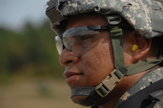 Competitor, Staff Sgt. Jorge Toro, scans the range prior to the qualification event of the 2007 Department of the Army Noncommissioned Officer/Soldier of the Year Competition at Fort Lee, Va., Oct. 4.