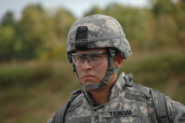 Competitor, Staff Sgt. Victor Trinidad, scans the range prior to the qualification event of the 2007 Department of the Army Noncommissioned Officer/Soldier of the Year Competition at Fort Lee, Va., Oct. 4.
