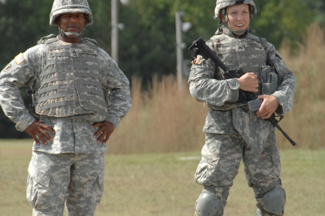 Competitor Sgt. Jamiell Goforth waits for her turn during the barrier firing exercise portion of the M4 qualification event of the 2007 Department of the Army Noncommissioned Officer/Soldier of the Year Competition at Fort Lee, Va., Oct. 4.""