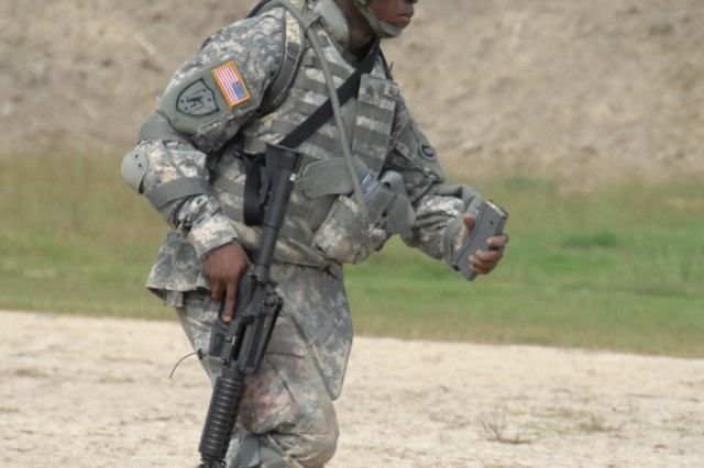 Competitor Sgt. Sadat Allhassan maneuvers through the barrier firing exercise portion of the M4 qualification event of the 2007 Department of the Army Noncommissioned Officer/Soldier of the Year Competition at Fort Lee, Va., Oct. 4.""