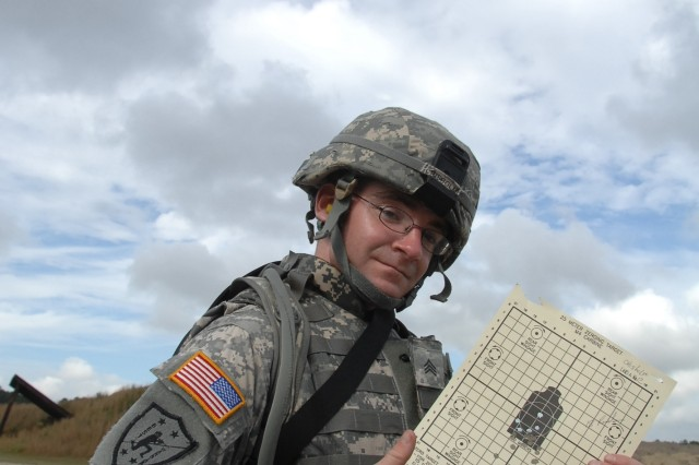 Competitor, Sgt. Edward Chisholm, points out his grouping after zeroing his M4 prior to the qualification event of the 2007 Department of the Army Noncommissioned Officer/Soldier of the Year Competition at Fort Lee, Va., Oct. 4.