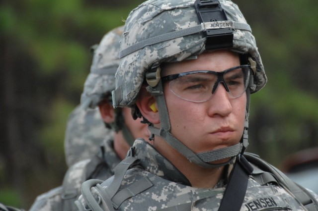 Competitor Sgt. Martin Jensen listens intently while instructions given prior to the M4 qualification event of the 2007 Department of the Army Noncommissioned Officer/Soldier of the Year Competition at Fort Lee, Va., Oct. 4.