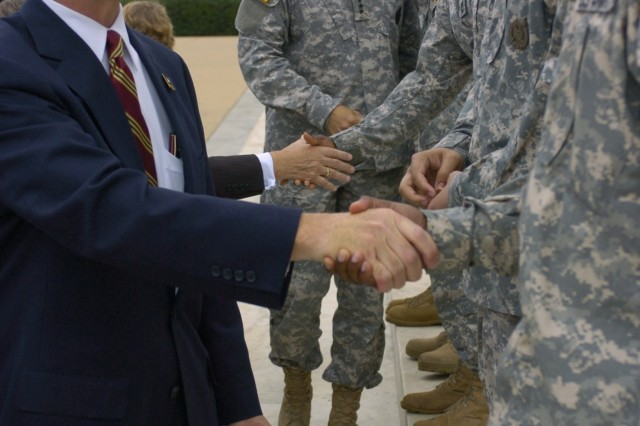 Secretary of the Army Pete Geren congratulates Soldiers on their reenlistment during the Recruiting Mission Success Ceremony at the Jefferson Memorial in Washington, D.C., Oct. 4.