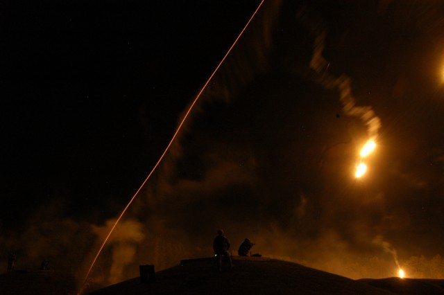 """Competitors in the 2007 Department of the Army Soldier and Noncommissioned Officer of the Year """"Best Warrior"""" Competition participate in the night fire exercise Oct. 4 at Fort Lee, Va."""