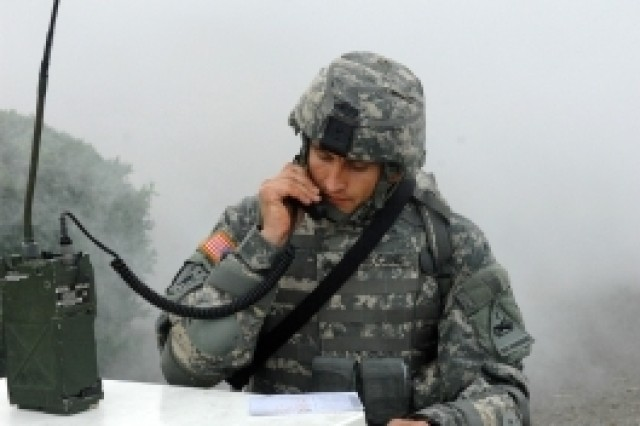 Cpl. Mihai Mocanu, U.S. Army Europe, calls in a nine-line medical evacuation request, during the Warrior Tasks and Battle Drills event, Oct. 4, in the Department of the Army NCO/Soldier of the Year Competition at Fort Lee, Va.