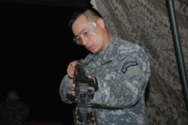 Competitor Spc. Heyz Seeker assembles a crew-served weapon during the 2007 Noncommissioned Officer/Soldier of the Year competition Oct. 4 at Fort Lee, Va.