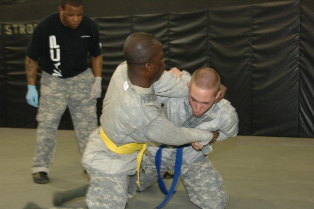 Competitors Sgt. Sadat Allhassan and Staff Sgt. Brian Yoder battle it out in the combatives ring during the 2007 Department of the Army Noncommissioned Officer and Soldier of the Year Competition at Fort Lee, Va.