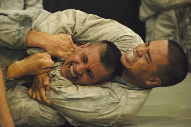 """Competitors Pfc. Patrick Murphy and Cpl. Mihai Mocanu battle it out in the combatives ring during the 2007 Department of the Army Noncommissioned Officer/Soldier of the Year """"Best Warrior"""" Competition at Fort Lee, Va. The competition concluded with combatives Friday morning. The winners are scheduled to be announced Oct. 8 at an award ceremony in Washington, D.C."""""""