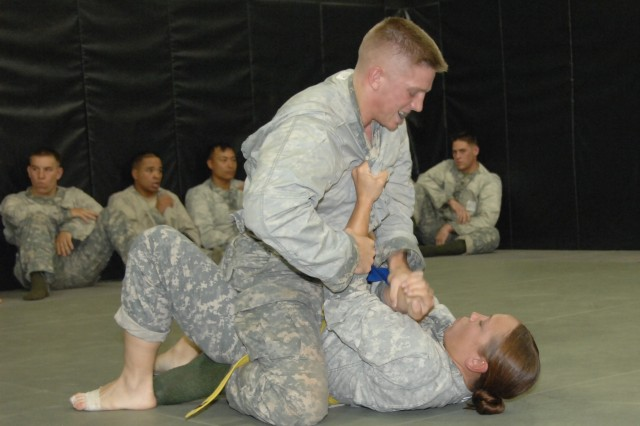 """Competitors Sgt. Steven Rovelstad and Sgt. Jamiell Goforth battle it out in the combatives ring during the 2007 Department of the Army Noncommissioned Officer and Soldier of the Year Competition at Fort Lee, Va."""""""