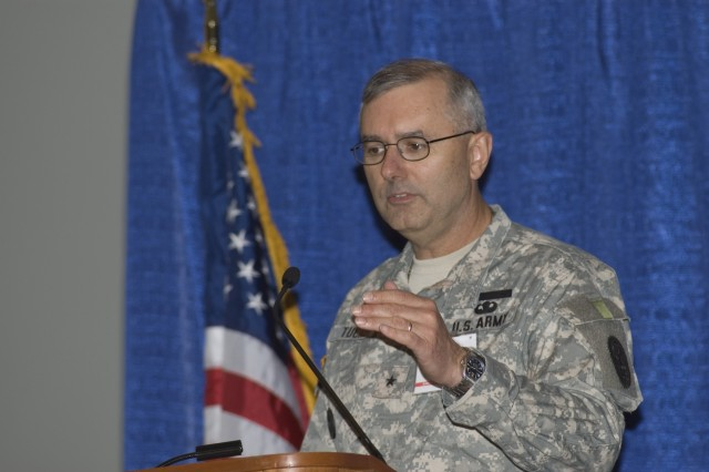 Brig. Gen. Mike Tucker addresses members of the Association of the U.S. Army Oct. 8 during a panel discussion on the Army Medical Action Plan.